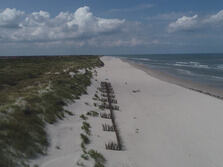Panorama photo of sand trap fences on the East Frisian island Langeoog